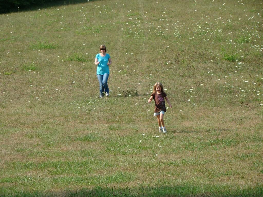 Tanya and Mackenzie running downhill