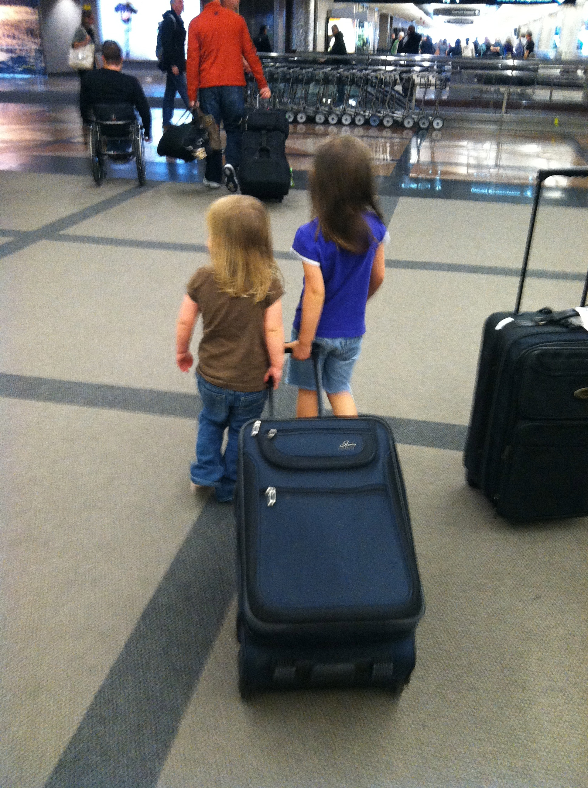 Kids helping at the airport